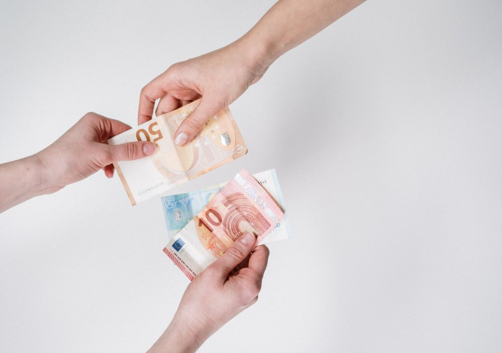 person-holding-10-and-10-euro-banknotes-3943746
